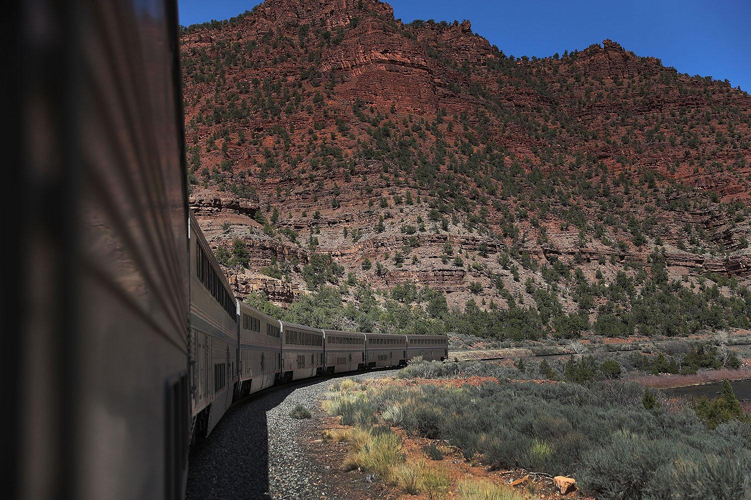 <p>Amtrak's California Zephyr rolls along the rails during its daily 2,438-mile trip to Emeryville/San Francisco from Chicago, March 24, 2017, in Glenwood Springs, Colo. (Photo: Joe Raedle/Getty Images) </p>