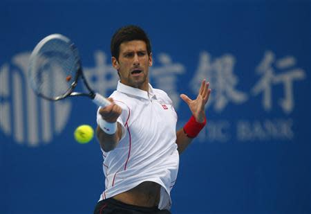 Serbia's Djokovic returns shot during match against Rosol of Czech Republic at the China Open tennis tournament in Beijing