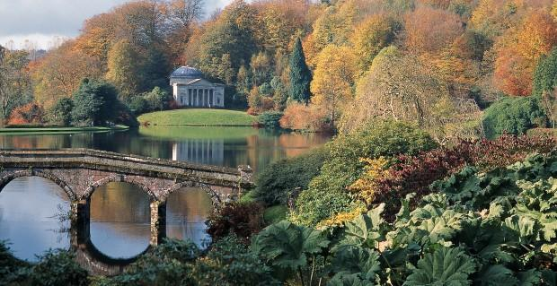 """<p>Stourhead is a 2,650 acre<a href=""""http://www.nationaltrust.org.uk/stourhead/"""" target=""""_blank"""">National Trust</a>estate, and home to some of the best 18th-century landscaped gardens in the world. In autumn its oaks and beeches are ablaze with reds, golds and yellows, and you can spend a whole day just exploring its classical follies, or relaxing by its elegant lake. Don't forget to pop into the Palladian mansion itself, and venture into the ancient woodland that also forms part of the estate—you'll see the contrast between this and the meticulously kept gardens.</p>"""