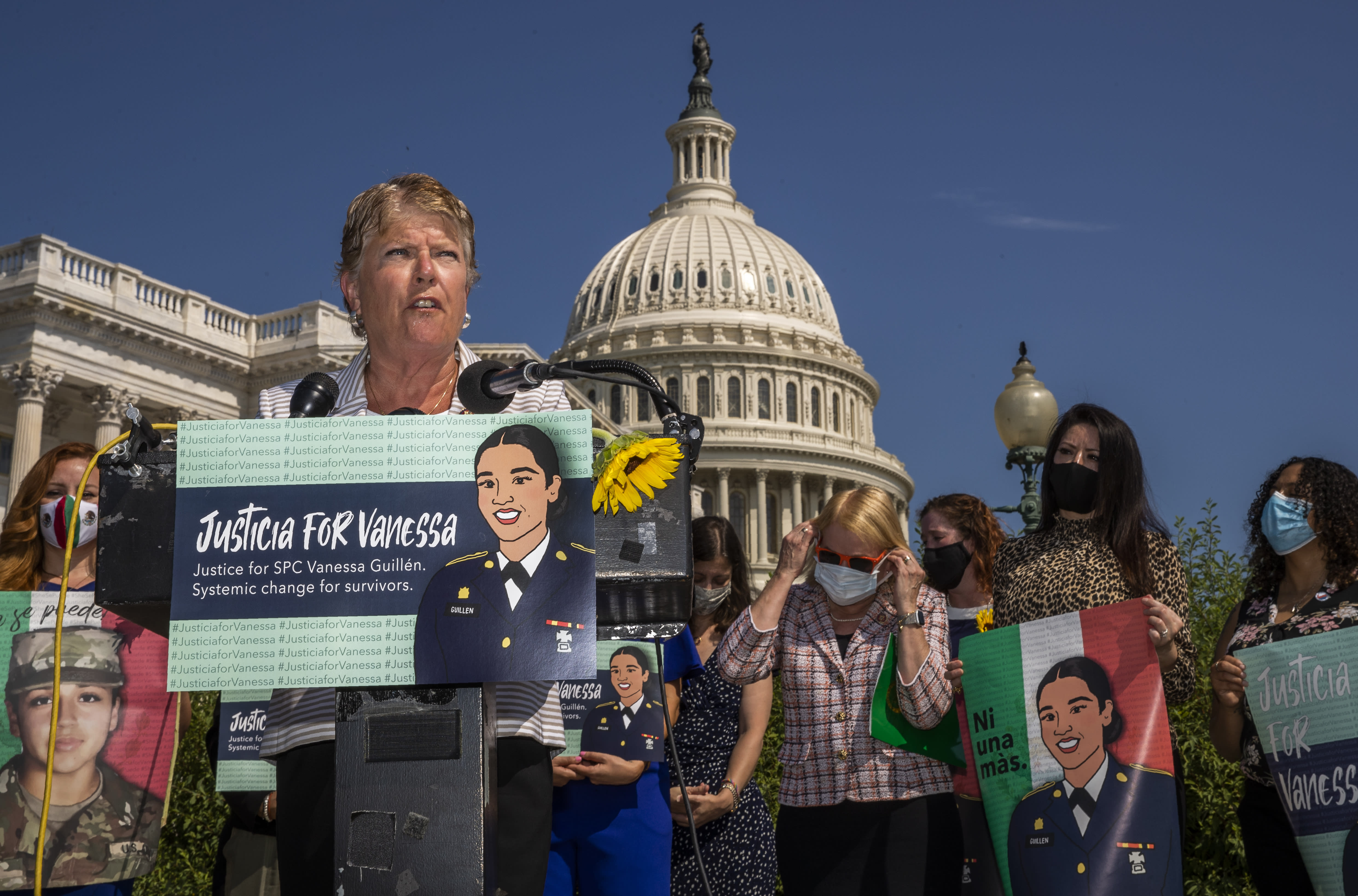 Rep. Julia Brownley, D-Calif., together with other lawmakers and supporters speaks during a news conference on Capitol Hill about ending sexual harassment and assault in the U.S. military and Department of Veterans Affairs Tuesday, July 21, 2020, in Washington. (AP Photo/Manuel Balce Ceneta)