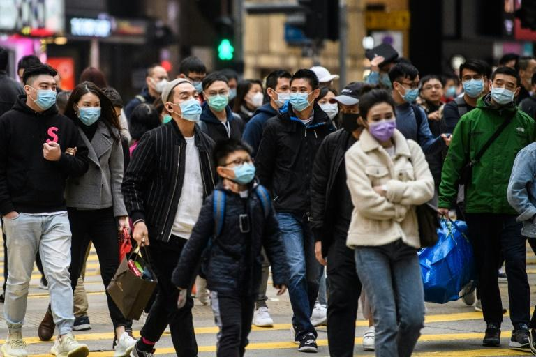 Investors are increasingly worried about the economic impact of the coronavirus, which has now killed at least 132 people and infected more people in China than SARS (AFP Photo/Anthony WALLACE)