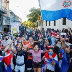 Fire, smoke, gunshots in Paraguay capital as pandemic response ignites protests