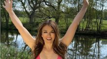 Elizabeth Hurley, 54, embraces quarantine life wearing a pink bikini and denim shorts: 'Spring has sprung'