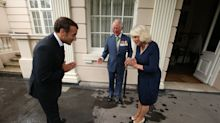 President Macron breaks social distancing rules by touching Prince Charles on arm during London visit