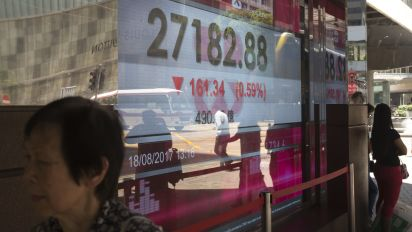 Asian shares track Wall Street slide; Spain attack weighs