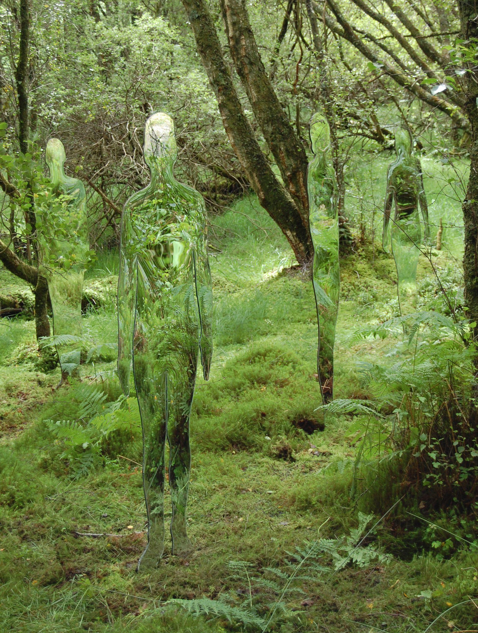 """Mirrored sculptures are displayed at the David Marshall Lodge near Aberfoyle in the Trossachs near Loch Lomond, Scotland. The installation is part of the town's regeneration and conveys the changes that have occurred in the landscape over the last few hundred years. The """"invisible"""" figures appear to blend into the wooded background. (Photo by Rob Mulholland / Rex Features)"""