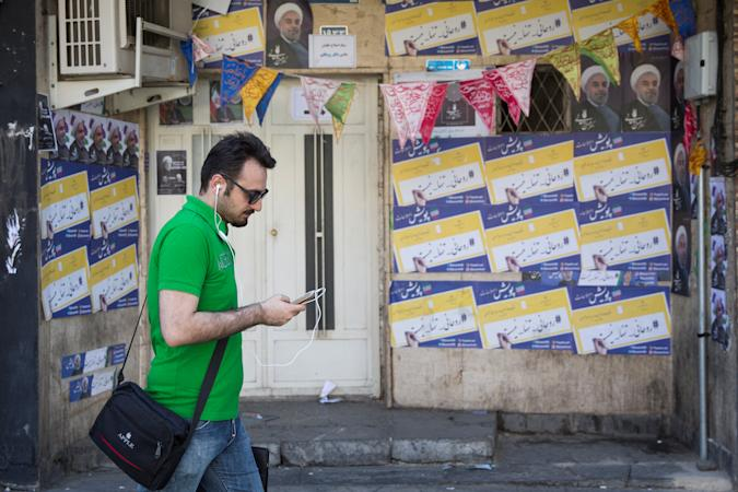 A man uses his smartphone to follow election news in Tehran, Iran May 17, 2017. REUTERS/TIMA ATTENTION EDITORS - THIS IMAGE WAS PROVIDED BY A THIRD PARTY. FOR EDITORIAL USE ONLY.