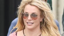 Britney Spears' Crop Top, Low-Rise Shorts & Platform Sandals Are Peak 2000s Style