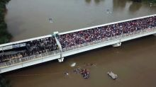 See the migrant caravan from above