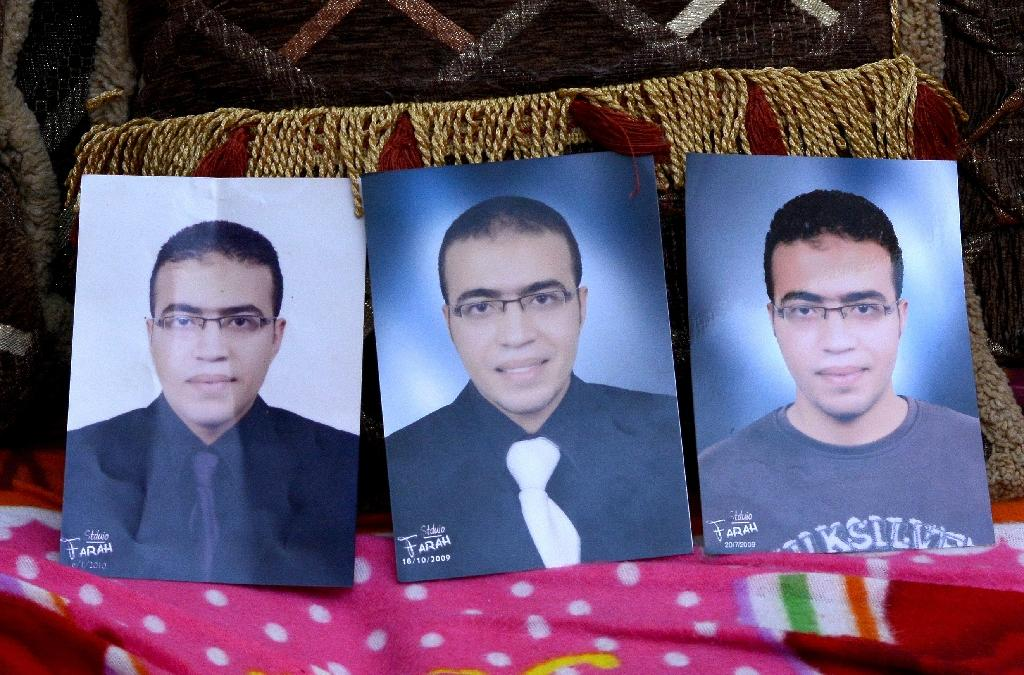 Portraits of Abdallah El-Hamahmy, an Egyptian suspected of being the machete attacker in Paris's Louvre museum, placed on a sofa at the family home in the Nile delta city of Mansura, some 120 kms north of Cairo (AFP Photo/Mahmood SHAHIIN)