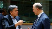 Greece, lenders agree to work out new reforms to unblock aid