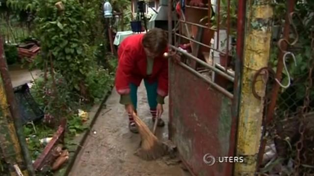 Picking up the pieces after floods inundate Bulgaria