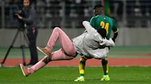 Ivory Coast v Senegal match abandoned after fan brings player to the ground