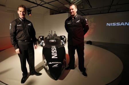 Darren Cox and concept creator Ben Bowlby stand next to Nissan's new Deltawing racing car after it was unveiled in London