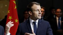 In China, Macron urges openness, pitches France Inc