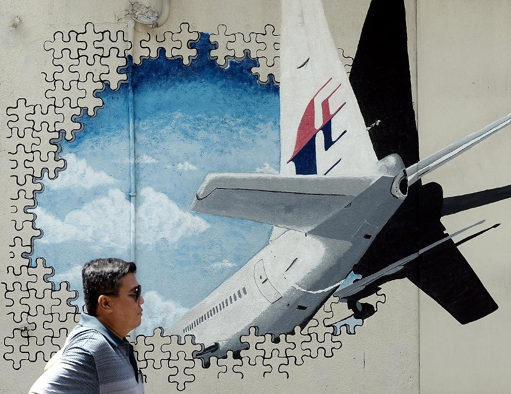 The Malaysia Airlines jet with 239 people on board disappeared in March 2014 en route from Kuala Lumpur to Beijing, sparking a massive underwater search in the remote southern Indian Ocean (AFP Photo/MANAN VATSYAYANA)