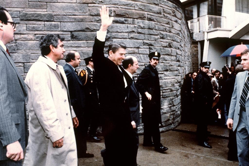 US Secret Service agent Jerry Parr (2nd left) was in charge of the security detail on the day US President Ronald Reagan was shot by John Hinckley outside the Hilton Hotel in Washington, D.C. on March 30, 1981
