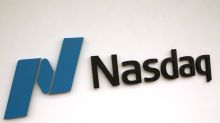 Nasdaq hits record high as U.S. economy shows signs of rebound