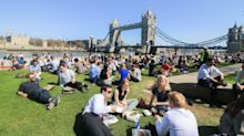 Summer's started! Britain basks in long-overdue sun as temperatures hit 27C