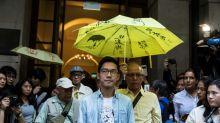 Activist Nathan Law flees Hong Kong as protest slogan outlawed
