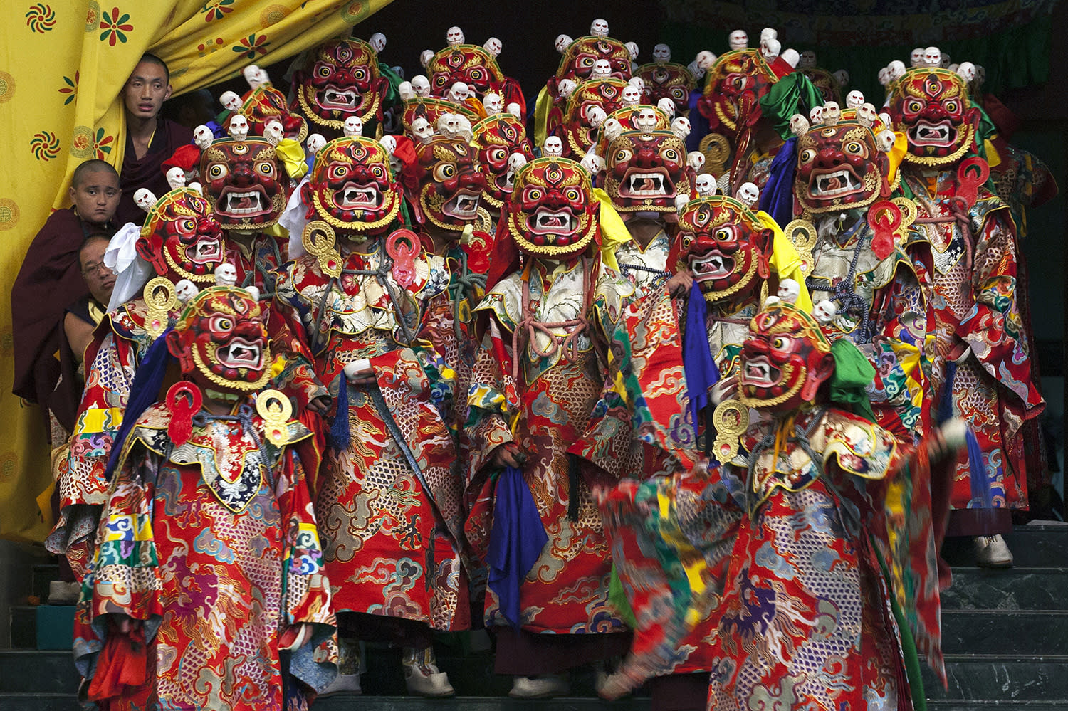 <p>Tibetan Buddhist monks perform a dance called 'cham' wearing traditional masks, at the Sherabling monastery, about 70 kilometers (40 miles) south of Dharmsala, India, Dec. 9, 2016. (Photo: Ashwini Bhatia/AP) </p>