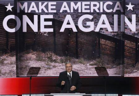 FILE PHOTO: Maricopa County, Arizona, Sheriff Joe Arpaio speaks in front of an image of a border fence during the last day of the Republican National Convention in Cleveland, Ohio, U.S. July 21, 2016. REUTERS/Mike Segar
