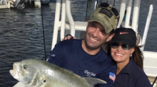 Kimberly Guilfoyle and Donald Trump Jr. catch and release massive yellowtail fish while on Florida vacation