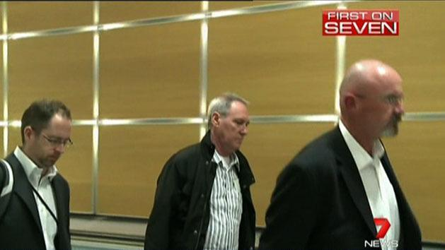 Hughes flies home to face child sex charges