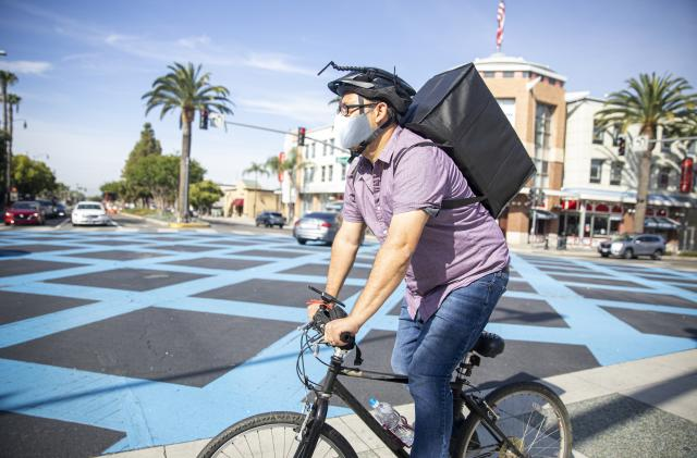 Uber is reportedly trying to buy Postmates