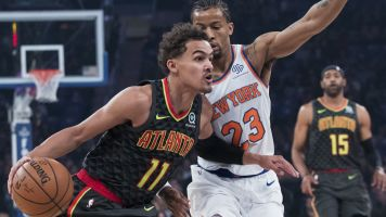 Trae Young learns a lot in 'humbling' debut