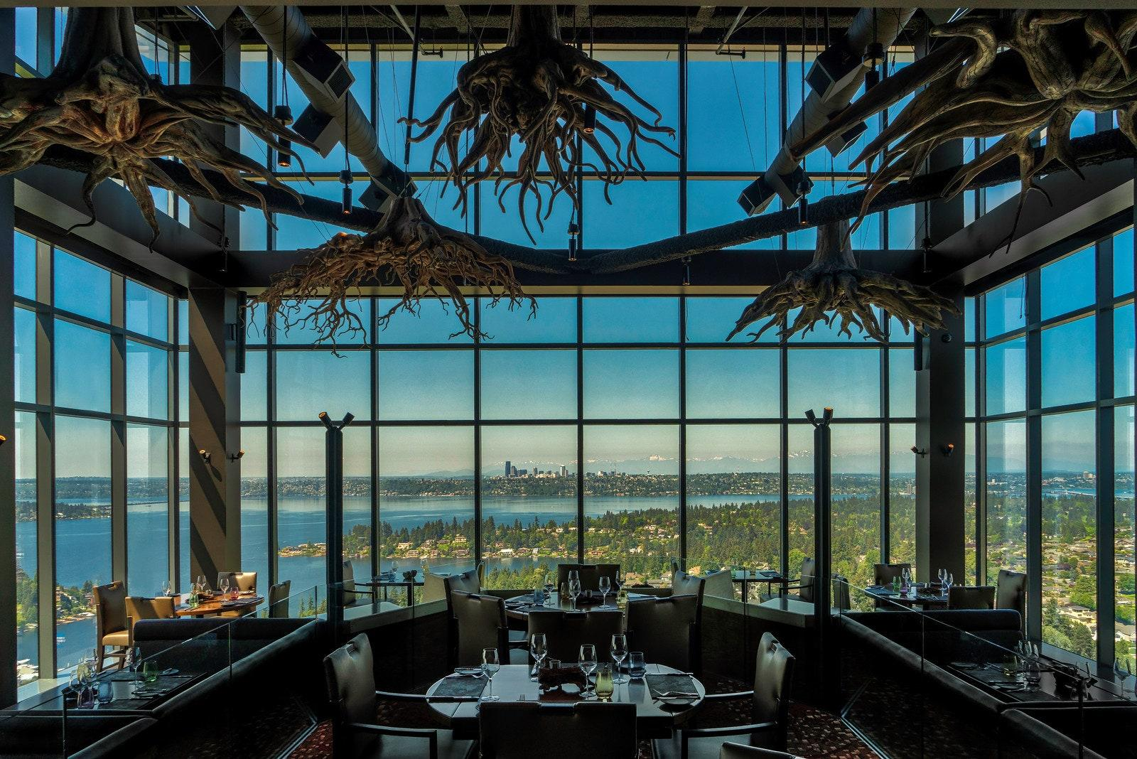 """Opened in June 2018, the aptly named Ascend Prime Steak & Sushi is located at the top of a corporate building, allowing guests to take in the stunning view of Seattle's verdant scenery and stunning architecture. The interior is nothing but elegant as well. Designed by Las Vegas–based DezMotif Studios, the main dining area features enormous cast replicas of tree roots suspended in the air. The trees in the dining room are the exact same wood that the chefs use in the kitchen to grill meat and poultry. <em>10400 NE 4th St, Suite 3100, Bellevue, Washington</em> <a href=""""https://ascendprime.com/"""" rel=""""nofollow noopener"""" target=""""_blank"""" data-ylk=""""slk:ascendprime.com"""" class=""""link rapid-noclick-resp""""><em>ascendprime.com</em></a>"""