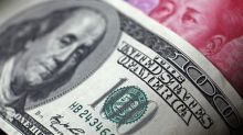 Yuan Slips, Dollar Gains as PBOC Loosens Monetary Policy