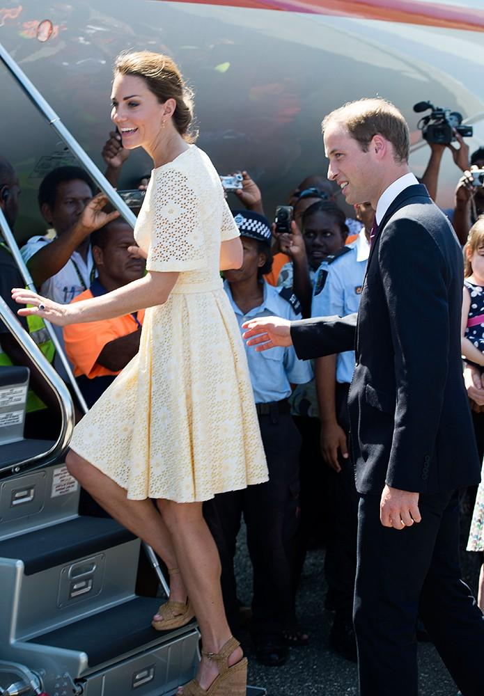 The royal couple boarded a plane, Kate wearing a pale yellow eyelet dress and Stuart Weitzman wedges.