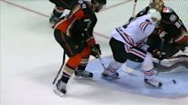 Hossa redirects puck with skate past Andersen