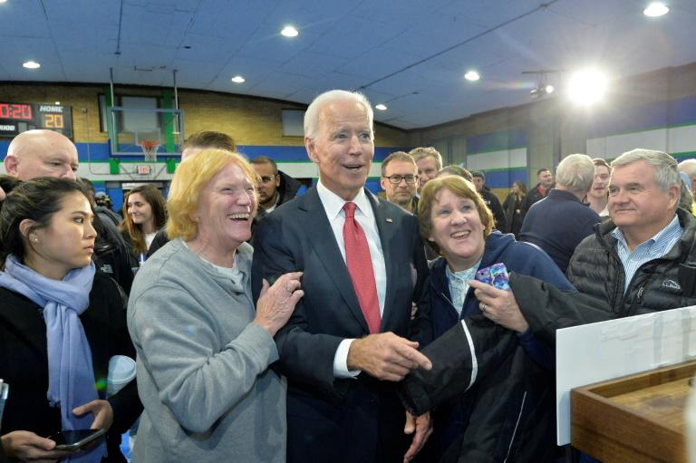 US presidential hopeful Joe Biden poses with supporters