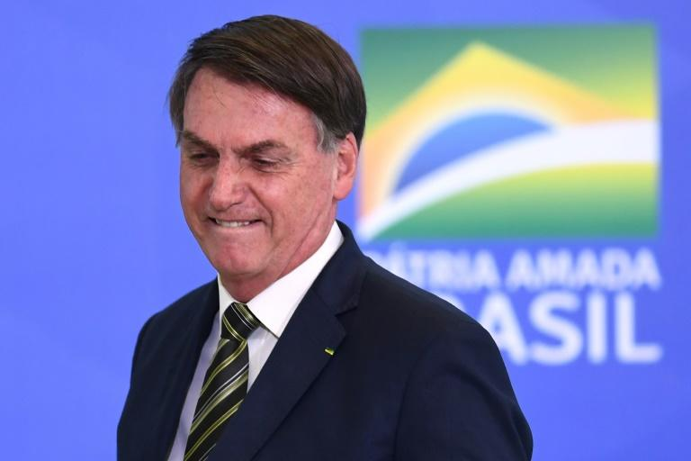Brazilian President Jair Bolsonaro, seen at the Planalto Palace in Brasilia on April 29, 2020, has shown little empathy for victims of the virus (AFP Photo/EVARISTO SA)