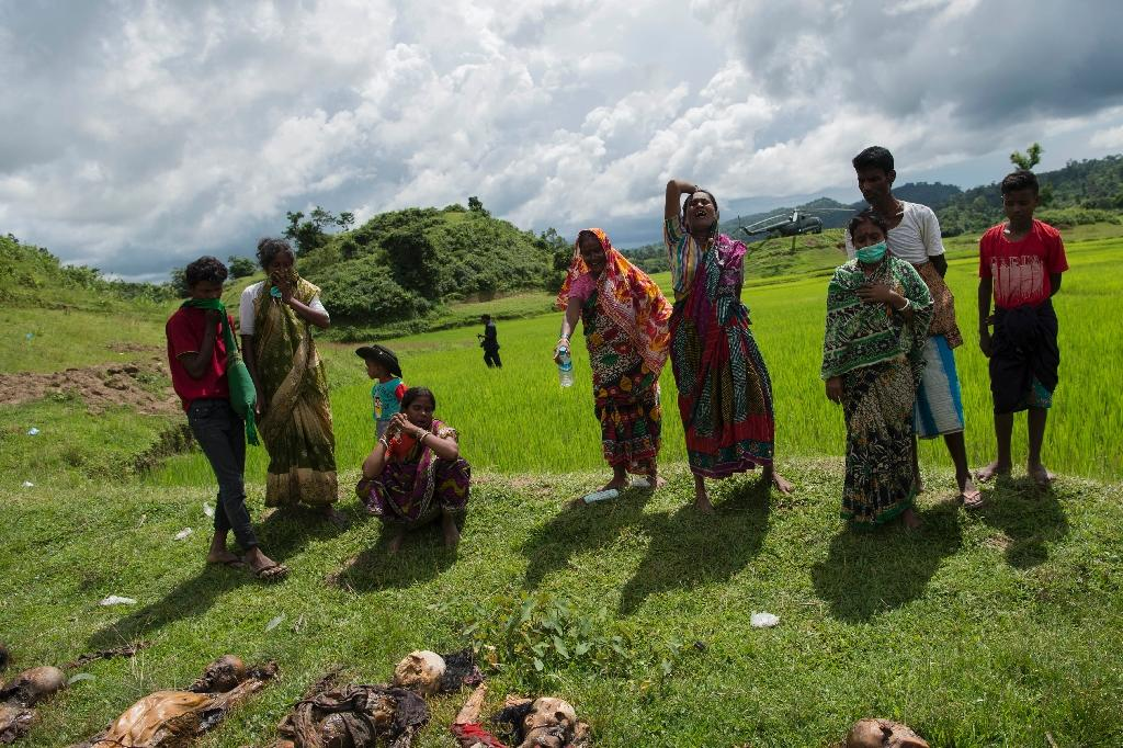 Hindus weep near the bodies of their family members in Ye Bauk Kyar village last September. They blame the massacre on Rohingya militants (AFP Photo/STR)