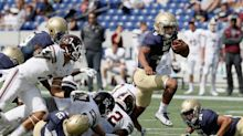 Navy QB who came out of stands to play in 2016 is switching positions