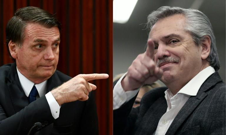 Brazilian President Jair Bolsonaro (L) expressed fears that a victory by Alberto Fernandez (R) would take Argentina on a path to economic ruin and spark an exodus