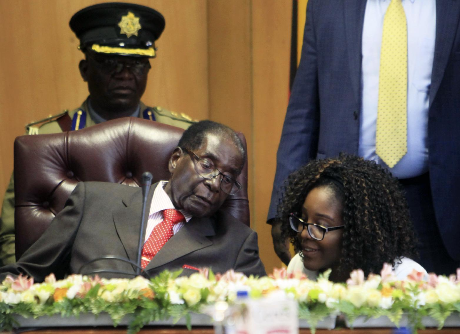 "Zimbabwe's President Robert Mugabe talks to his daughter Bona as he marks his 93rd birthday at his offices in Harare, Tuesday, Feb. 21, 2017. Mugabe described his wife Grace, an increasingly political figure, as ""fireworks"" in an interview marking his 93rd birthday. (AP Photo/Tsvangirayi Mukwazhi)"