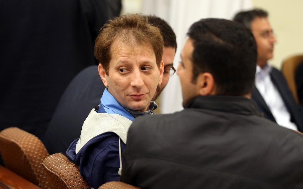 Babak Zanjani (centre) in court in Tehran in March this year (AFP Photo/)