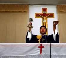 China's Catholic Church pledges loyalty to Party after Vatican deal