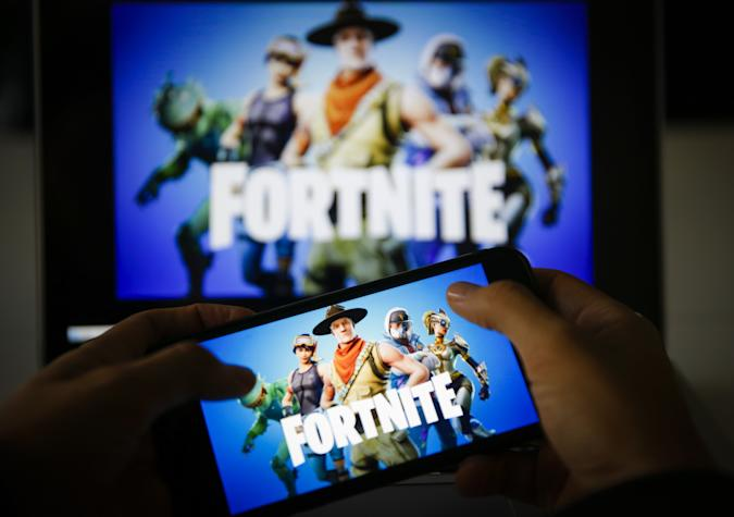 ANKARA, TURKEY - NOVEMBER 26: A man plays Fortnite game on smartphone in Ankara, Turkey on November 26, 2018.  (Photo by Metin Aktas/Anadolu Agency/Getty Images)
