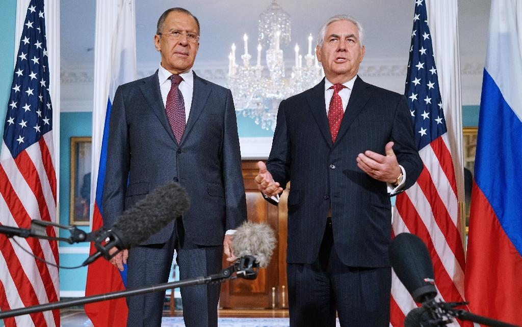 """US Secretary of State Rex Tillerson (R) who met with Russian Foreign Minister Sergei Lavrov ion May 10, 2017, said trust between the two nations was """"very low"""""""