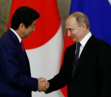 Russia's Putin, Japan's Abe call for talks, calm with North Korea