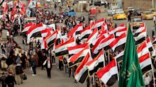 Gunmen in cars kill at least 15 and injure scores more in Baghdad protests