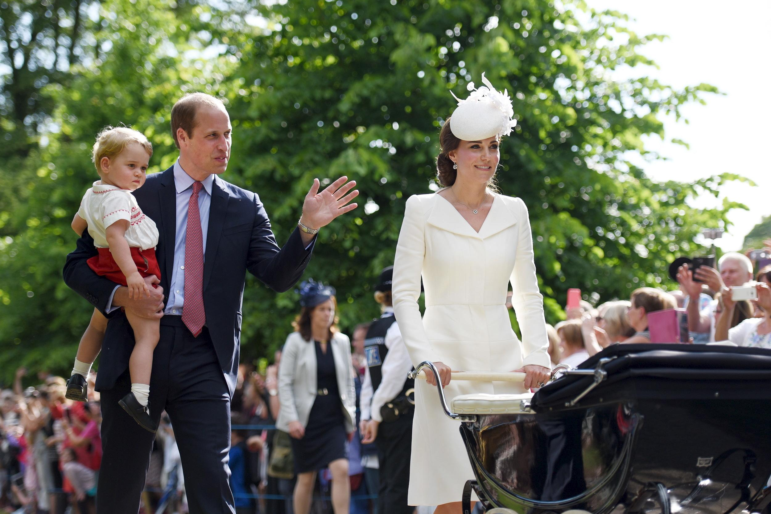 The Duke and Duchess of Cambridge walk past the crowds at the Church of St Mary Magdalene on the Sandringham Estate with their son Prince George and daughter Princess Charlotte, after her christening, on July 5th 2015. REUTERS/Mary Turner/Pool