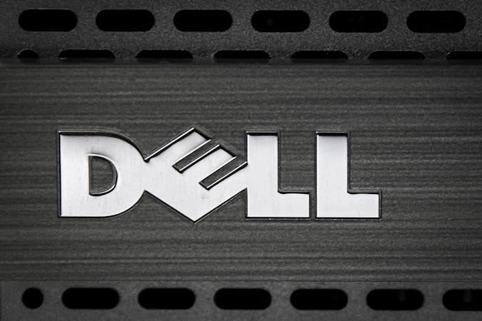 A Dell logo is pictured on the front of a computer in this photo illustration in the Manhattan borough of New York October 12, 2015. Computer maker Dell Inc said on Monday it had agreed to buy data storage company EMC Corp in a $67 billion record technology deal that will unite two mature companies and create an enterprise technology powerhouse.   REUTERS/Carlo Allegri