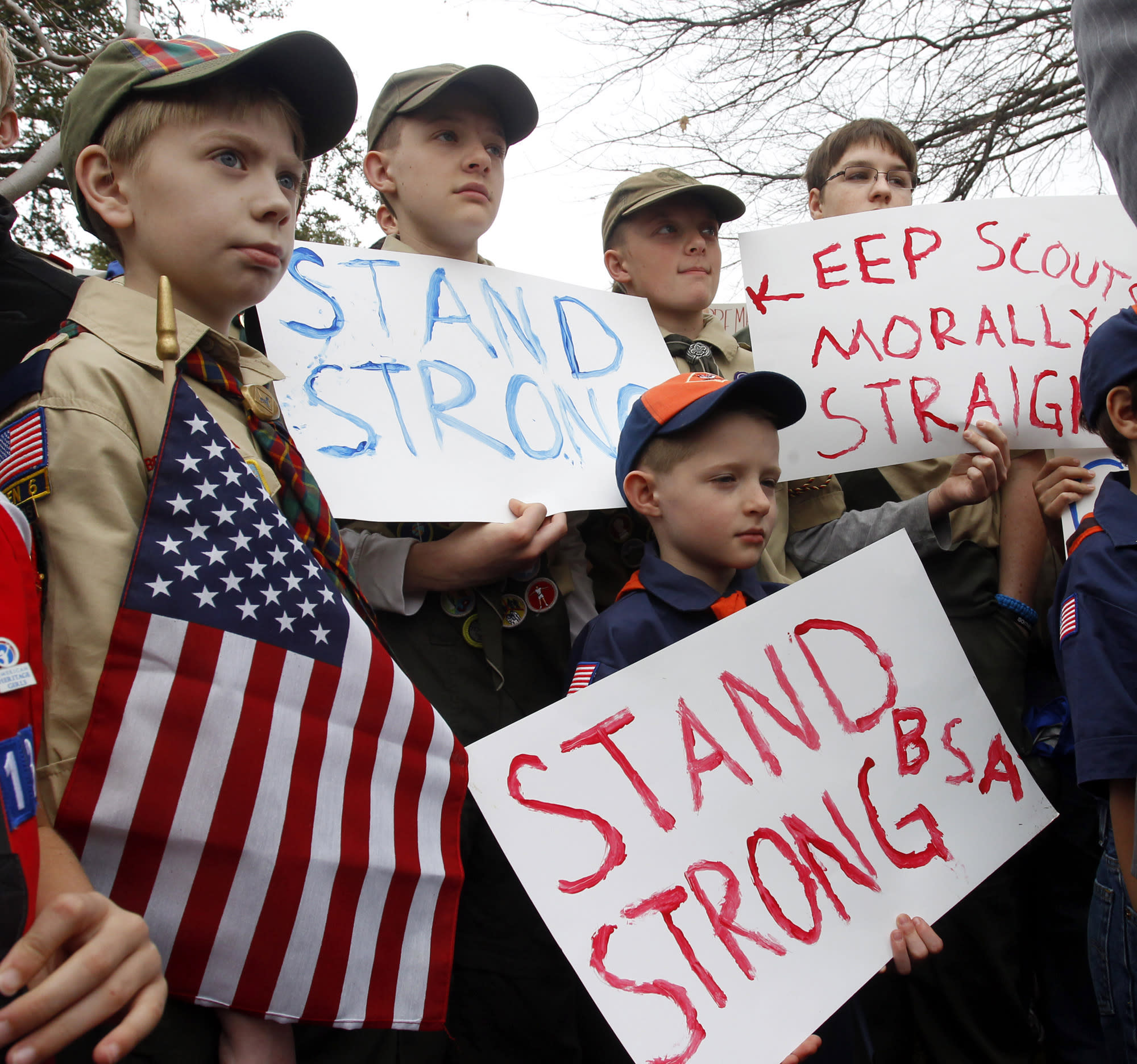 "Clockwise from left, Boy Scouts Eric Kusterer, Jacob Sorah, James Sorah, Micah Brownlee and Cub Scout John Sorah hold signs at the ""Save Our Scouts"" Prayer Vigil and Rally in front of the Boy Scouts of America National Headquarters in Irving, Texas, Wednesday, February 6, 2013. The Boy Scouts of America said Wednesday it needed more time before deciding whether to move away from its divisive policy of excluding gays as scouts or adult leaders. (AP Photo/Richard Rodriguez)"