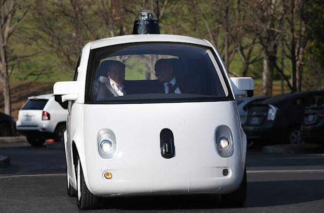 Google hires auto industry veteran to run self-driving car project